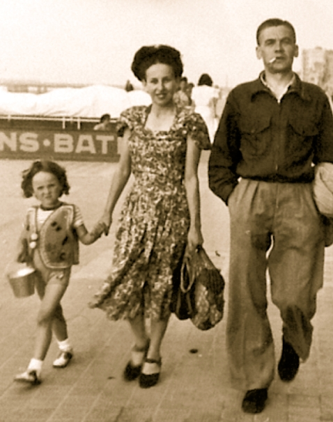 Belgium ca. 1948. Viviane and her parents on the walk board at the seaside.